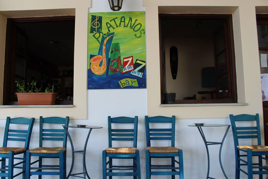 Blue chairs outside a local jazz bar on the Greek island of Skopelos