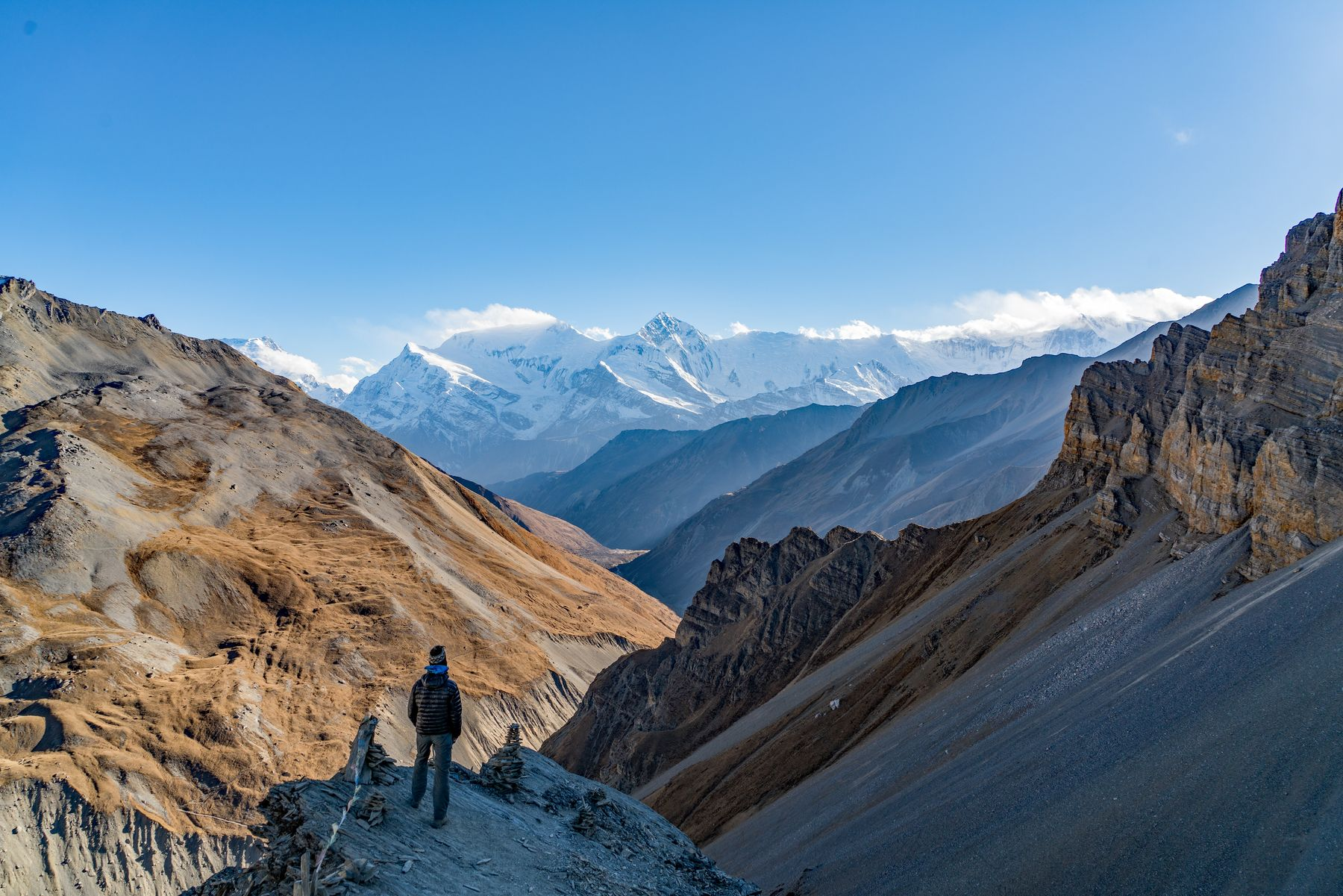 hiking from a distance looking out on a mountain range in Nepal, a dream destination