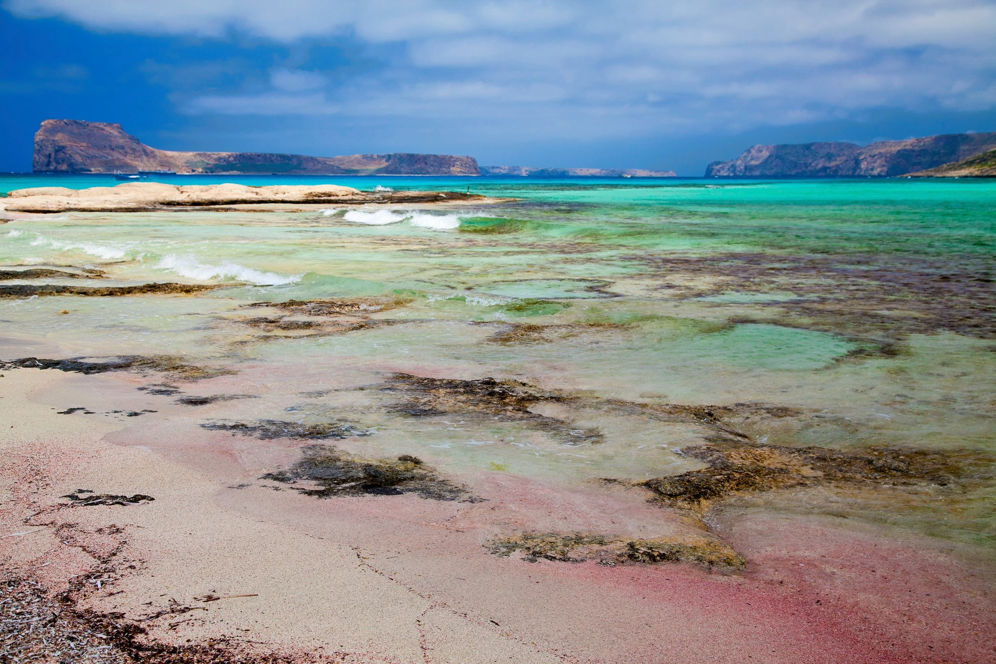 Pink sands and turquoise waters in Crete - a great destination for family holidays on a budget