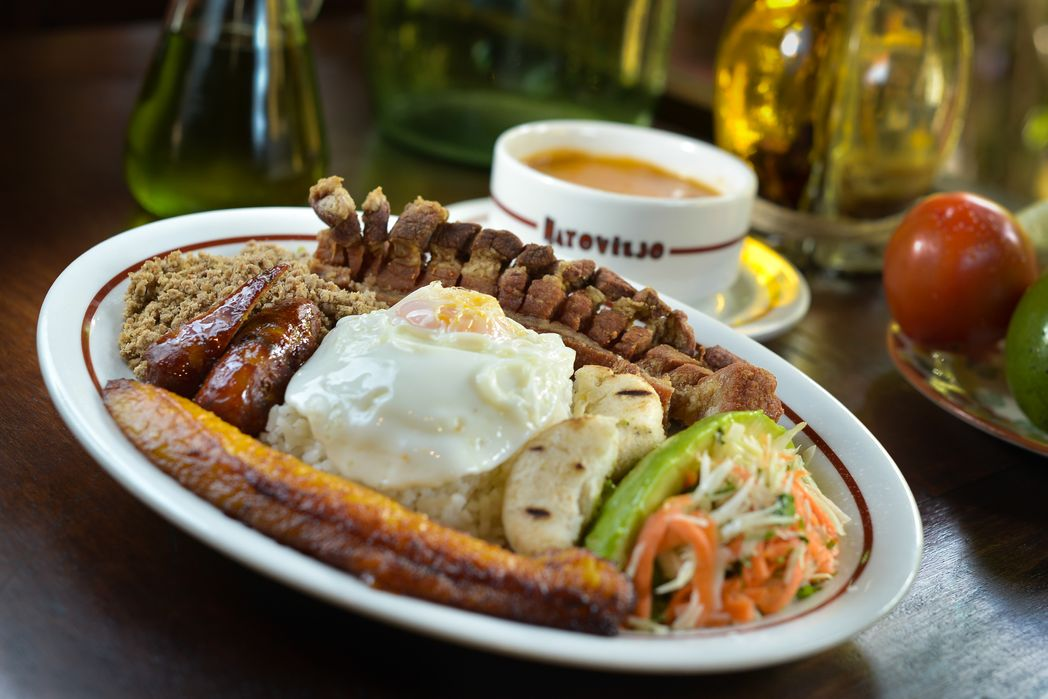 Bandeja Paisa with plantain, fried egg, rice, sausage and more - tasty reasons to visit Colombia