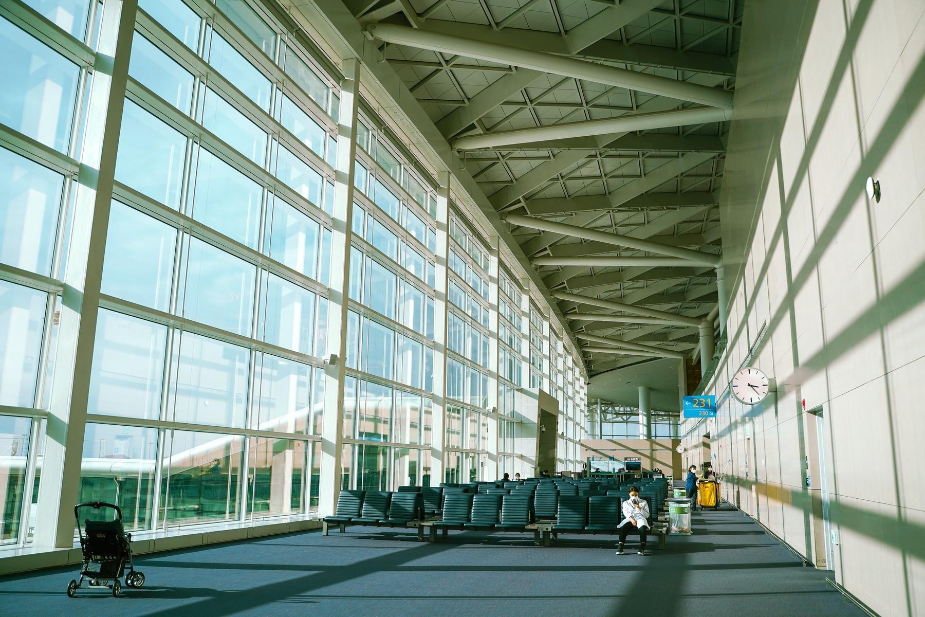 man sitting at an empty terminal