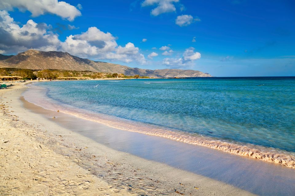 Book a flight from Ireland to Crete to visit the pink sands of Elafonissi Beach.