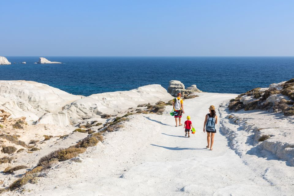 Tourists visiting a quiet beach in Milos, Greece
