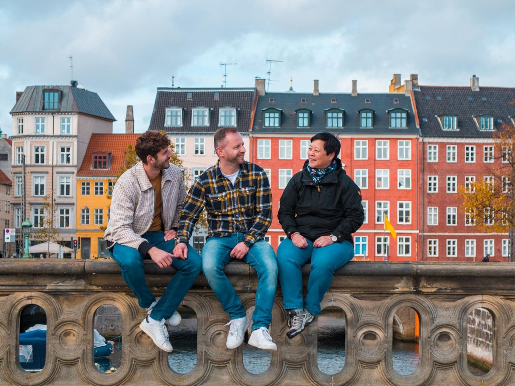 Three people enjoying Pride 2021 in Copenhagen.