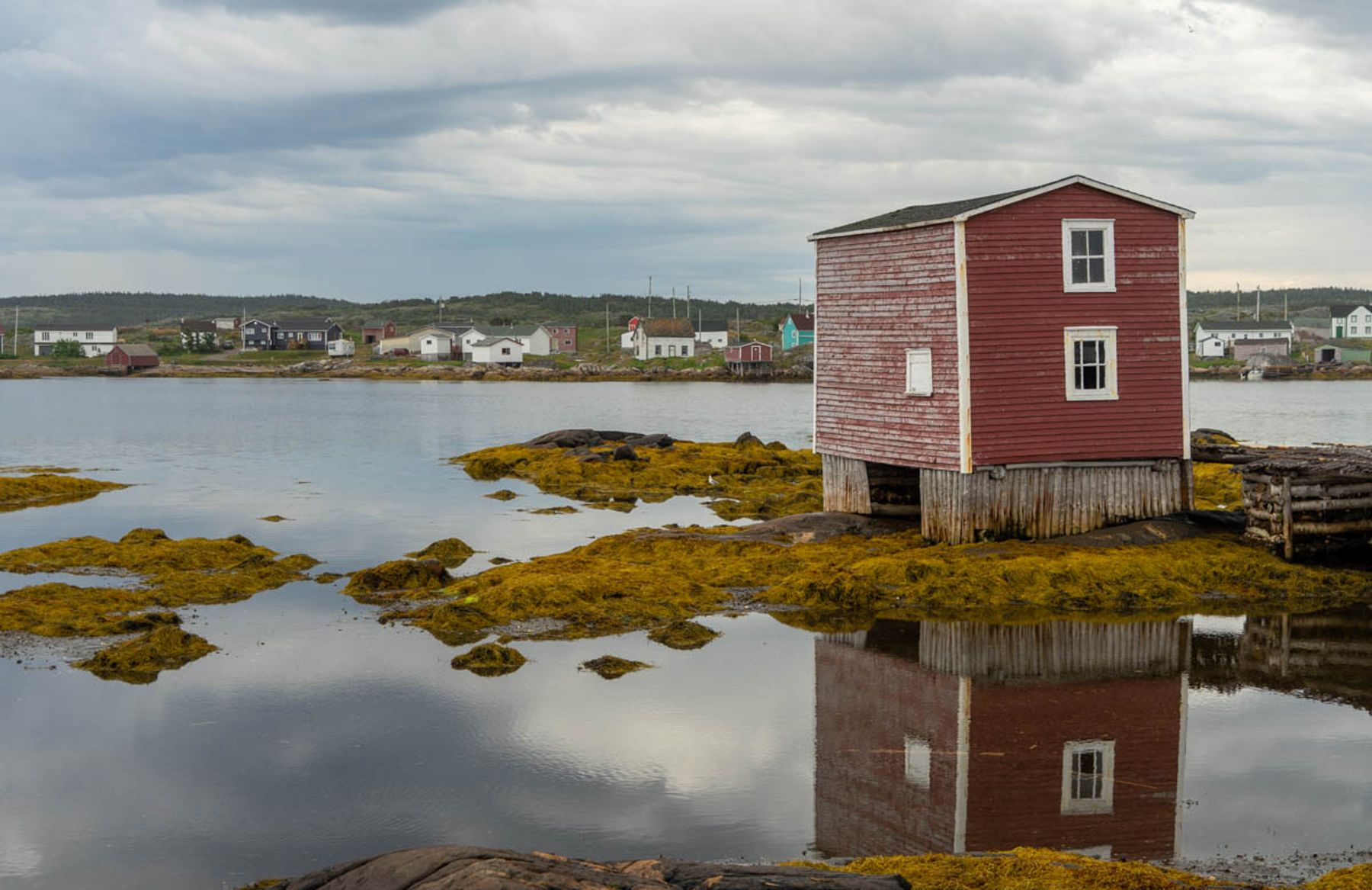 a painted red fishing stage by the shore in central Newfoundland