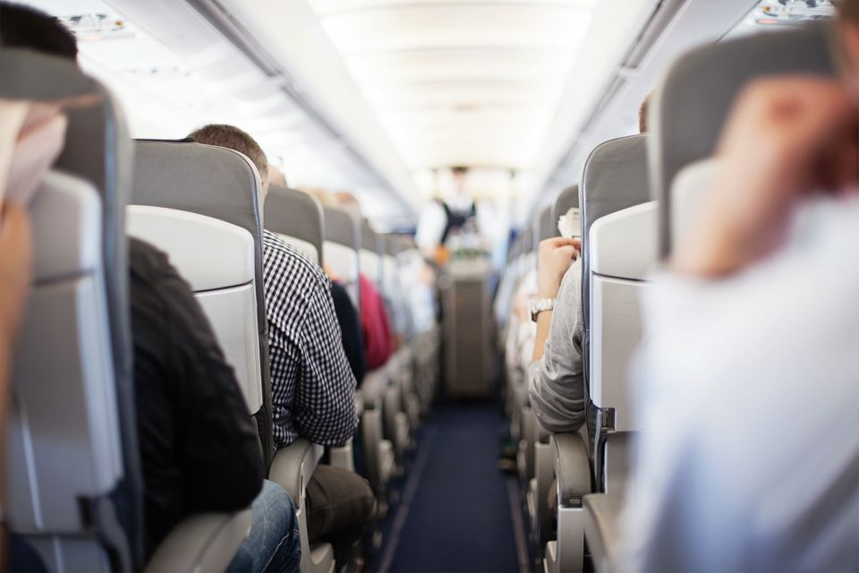 Passengers on a morning flight waiting for in-flight service