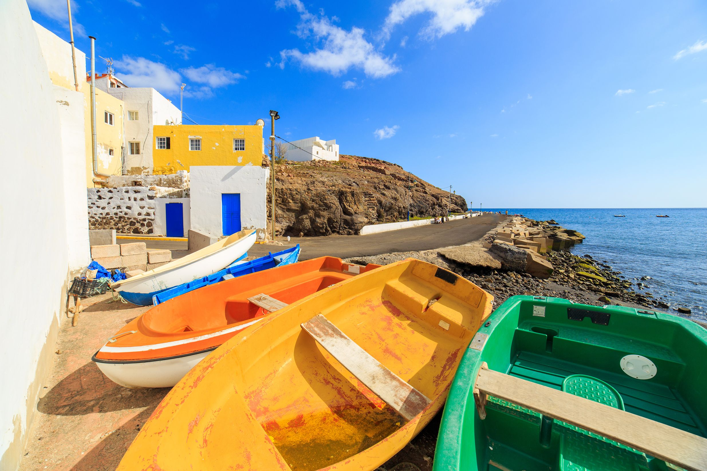 Colourful wooden fishing boats in a small port on the beach in Fuerteventura