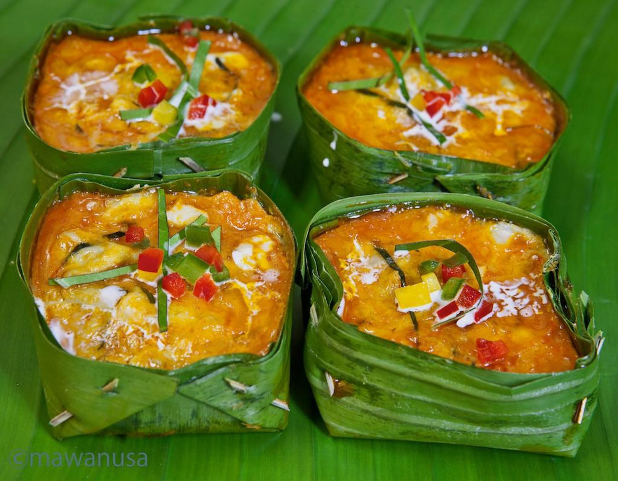 Fish Amok in banana leaf squares