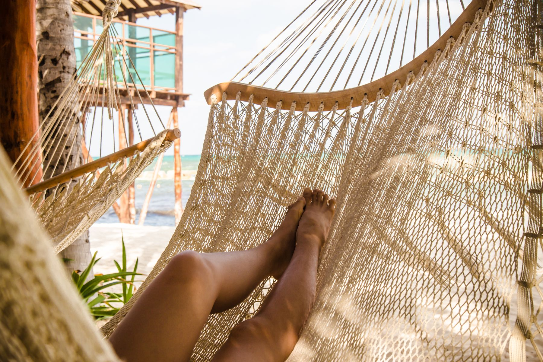 2021 travel trends: beach hotel with hammock